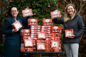Amy Bould and Sallie Allen with lots of mince pies and Christmas cakes